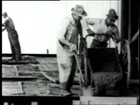 june 23, 1930 workers pouring concrete during empire state building construction / new york city, new york, united states - 1930 stock videos & royalty-free footage