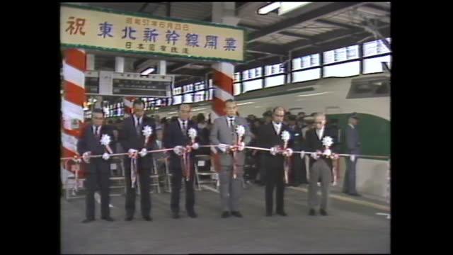 vídeos de stock, filmes e b-roll de june 23 as tohoku shinkansen was opened to traffic of 466 kilometerlong between omiya and morioka the commemoration events were held at respective... - cortando fita