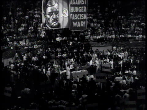 june 24 1936 ws spotlights flickering over delegates at communist convention / new york city new york united states - comunismo video stock e b–roll