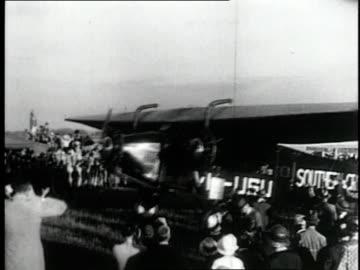stockvideo's en b-roll-footage met june 25, 1928 montage australian kingsford smith landing in fiji six days after leaving us pacific coast for longest sea flight ever / fiji - 1928