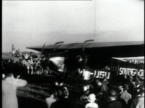 june 25 1928 montage australian kingsford smith landing in fiji six days after leaving us pacific coast for longest sea flight ever / fiji - 1928 stock-videos und b-roll-filmmaterial