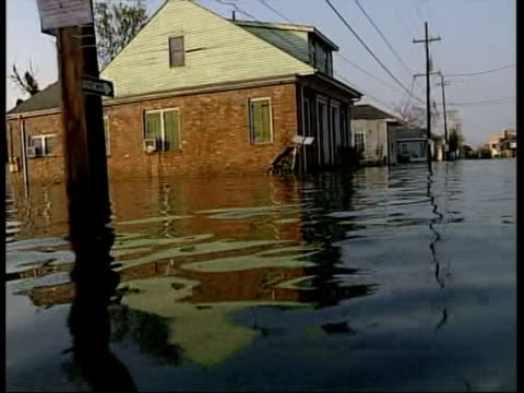 June 27 2005 FILM MONTAGE WS Houses and cars submerged in flood waters following Hurricane Katrina/ New Orleans Louisiana