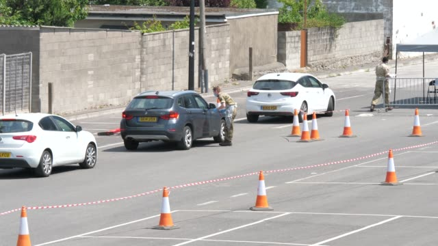 june 2nd 2020: various clips. army run, drive thru self testing site for covid-19 set up in an empty car park in weston super mare, somerset, uk. - medical examination stock videos & royalty-free footage