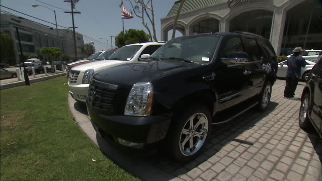 june 30, 2008 montage suvs on display on dealership lot / detroit, michigan, united states - 2000s style stock videos & royalty-free footage