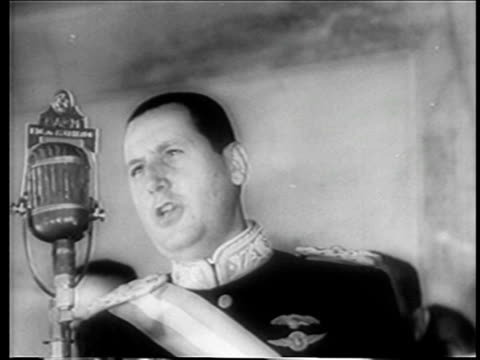 b/w june 4 1946 close up juan peron in uniform reading speech before microphone after inauguration / news - 1946年点の映像素材/bロール