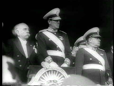 b/w june 4 1946 juan peron in uniform in watching military parade in his honor / buenos aires - 1946年点の映像素材/bロール