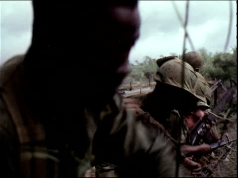 june 5, 1966 american soldiers throwing grenades from a foxhole during the vietnam war / dak to, vietnam - hand grenade stock videos & royalty-free footage