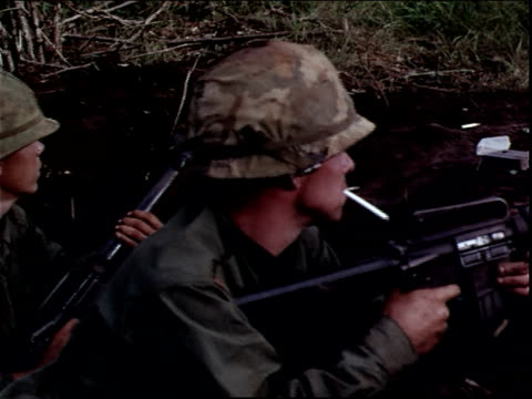 june 5 1966 montage american soldiers holding machine guns and smoking cigarettes in a trench during the vietnam war / dak to vietnam - m16 stock videos & royalty-free footage