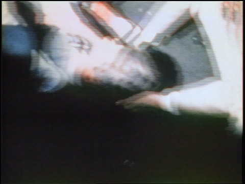 june 5 1968 2 men holding bleeding head of robert kennedy talking to him after assassination - 1968年点の映像素材/bロール