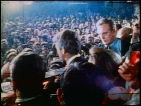 june 5 1968 rear view robert kennedy making speech to crowd at rally before assassination / low angle - 1968年点の映像素材/bロール