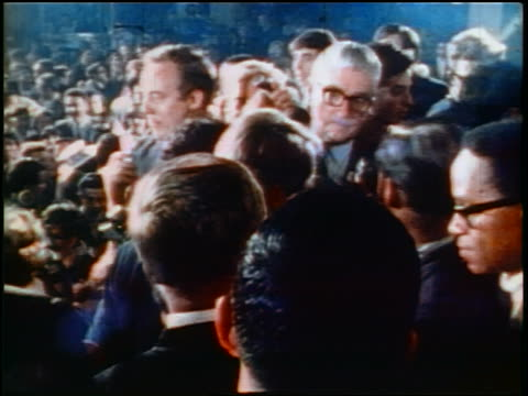 june 5 1968 robert kennedy leaving podium at crowded rally just before assassination / los angeles - 1968年点の映像素材/bロール