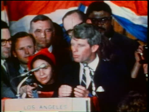 june 5 1968 robert kennedy making speech at podium / crowd of people behind him / los angeles - 1968年点の映像素材/bロール