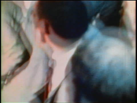 june 5 1968 shaky chaotic crowd around robert kennedy just after his assassination / los angeles - 1968年点の映像素材/bロール