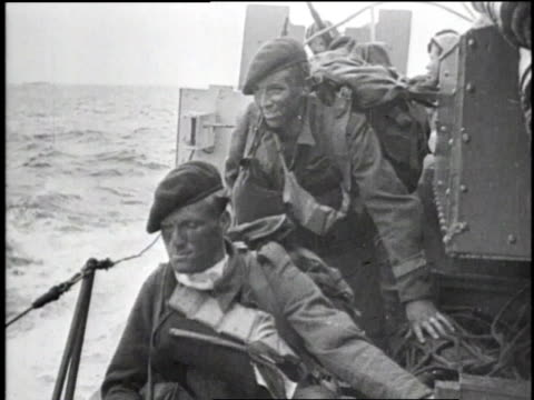 june 6 1944 montage us troops on amphibious landing craft / ms soldiers on boat / ms troops climbing out of amphibious landing craft at normandy /... - arromanches stock videos & royalty-free footage