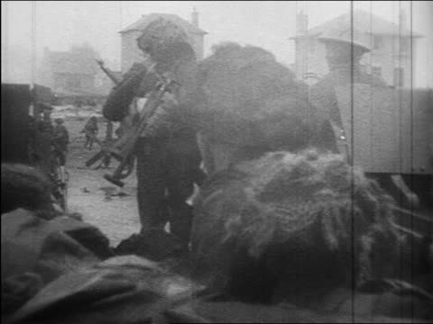 june 6 1944 rear view british troops storming beach at normandy / d-day / documentary - d day stock videos & royalty-free footage