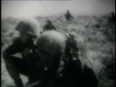 june 7 1967 montage israeli soldiers lying in wait on ground with fighter jets flying overhead during israeli six day war - sechstagekrieg stock-videos und b-roll-filmmaterial