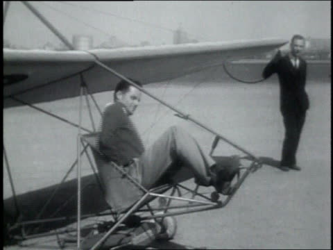 vídeos de stock e filmes b-roll de june 8, 1931 montage pilot demonstrating rocket glider at new jersey airstrip / atlantic city, new jersey, united states - 1930