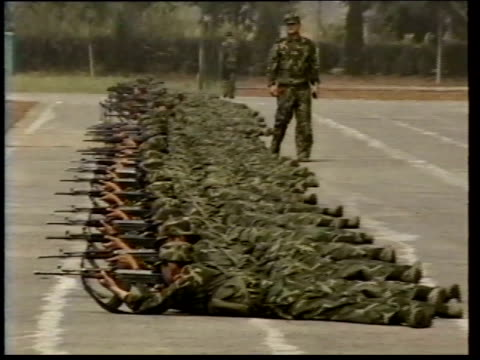 June 8 1993 ZO Formation of Chinese Army soldiers at prone firing practice / Beijing China