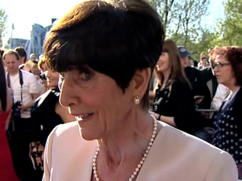 june brown on not watching tv not being nervous and liking a good book at the tv bafta awards at london - イーストエンダーズ点の映像素材/bロール