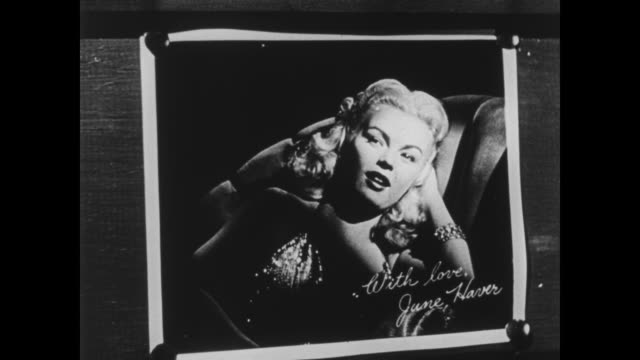june haver flirts from her photograph with a soldier - propaganda stock-videos und b-roll-filmmaterial