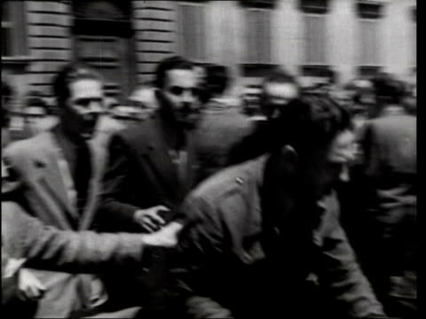 june in 1946 italy became a republic rome prince umberto speaking amongst people / man arguing with policeman / vast crowds in streets / newspaper... - 1946 stock-videos und b-roll-filmmaterial