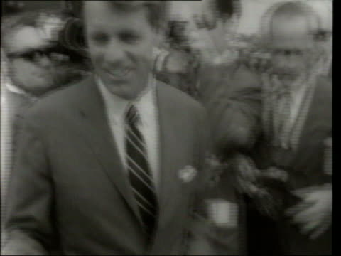 june in 1968 robert kennedy died california los angeles robert kennedy along through crowds and press to car / car parked outside ambassador hotel... - 1968 bildbanksvideor och videomaterial från bakom kulisserna
