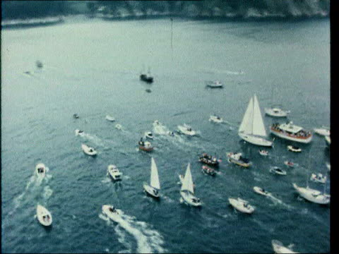 june; in 1978 naomi james broke the solo circumnavigation record lib at sea / england: aerial view of yachts at sea / naomi james waving from onboard... - circumnavigation stock videos & royalty-free footage