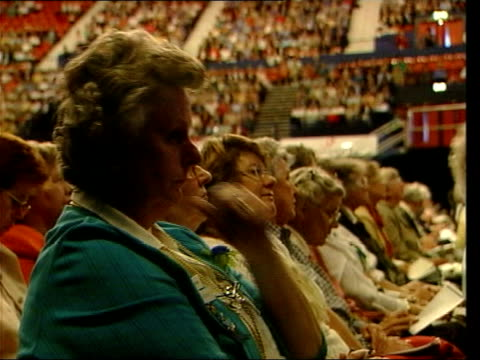 vídeos de stock e filmes b-roll de june in 2000 tony blair was heckled by the womens' institute int / ext tony blair mp on stage making speech at women's institute conference / women... - wembley arena