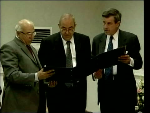 June In 2004 the USled coalition handed over power to the Iraqis Baghdad INT Paul Bremer reading from document as standing next Iyad Allawi and...