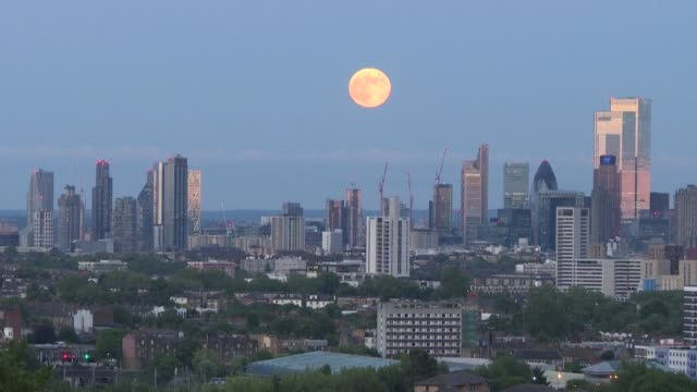 """june's full moon, also known as a """"strawberry moon"""" since it occurs during strawberry season, rises over the british capital, london - astronomy stock videos & royalty-free footage"""