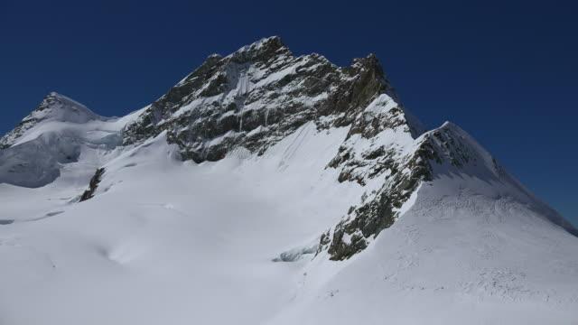 jungfrau, bernese alps, switzerland, europe - berner alpen stock-videos und b-roll-filmmaterial