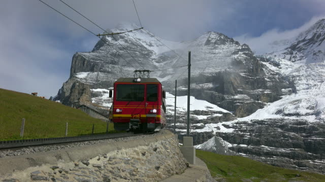 jungfraubahn railway and eiger, kleine scheidegg, bernese alps, switzerland, europe - famous place stock videos & royalty-free footage