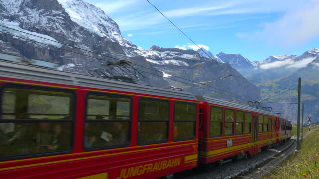 jungfraubahn railway at kleine scheidegg, bernese alps, switzerland, europe - tradition stock-videos und b-roll-filmmaterial