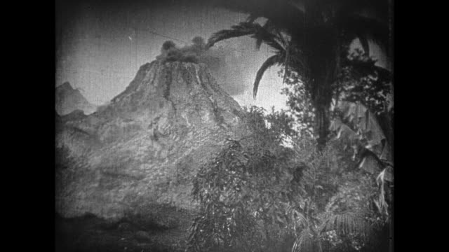 1925 jungle explorers notice erupting volcano in distance - 1925 stock videos & royalty-free footage