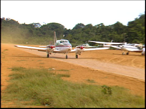 a jungle runway servicing a nearby gold mine in the amazon - roraima state stock videos and b-roll footage