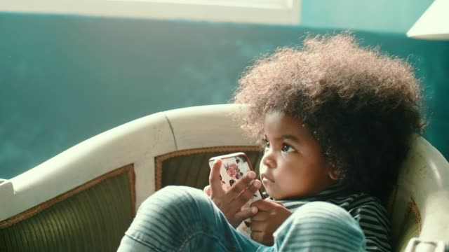 junior afro video gamer - baby girls stock videos & royalty-free footage