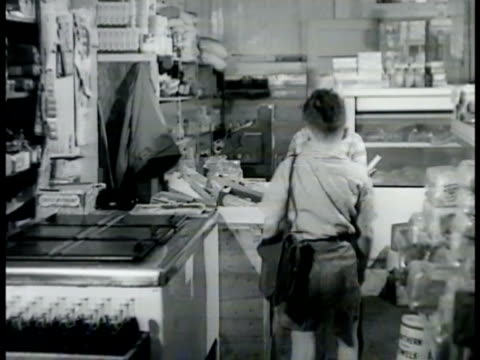 DRAMATIZATION 'Junior' and friend outside clapboard building looking at Blackstone magician poster 'Junior' buying candy in store MS boy finger...