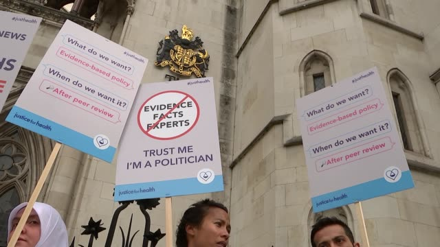 junior doctors protest outside high court; england: london: royal courts of justice: ext general views of junior doctors with placards protesting... - man and machine stock videos & royalty-free footage