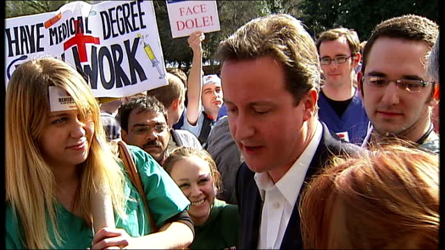stockvideo's en b-roll-footage met junior doctors protest over government jobs website female protester talking to david cameron mp sot if you'd told me six years training two years of... - teamevenement
