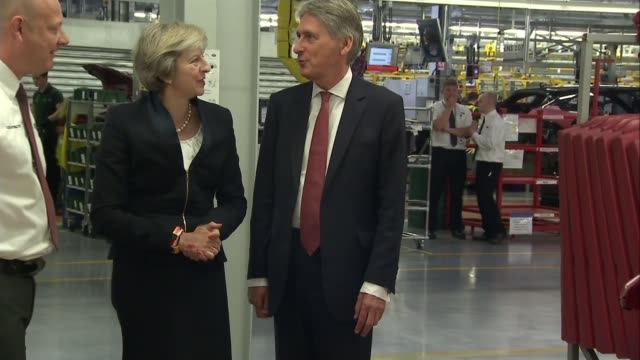 Further five day strikes announced ENGLAND West Midlands Solihull Jaguar Land Rover factory INT Various of Theresa May MP and Philip Hammond MP...