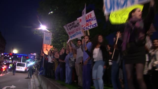 junior doctors to take strike action over contract changes lib london westminster photography*** various gvs of junior doctors protesting outside... - strike protest action stock videos and b-roll footage