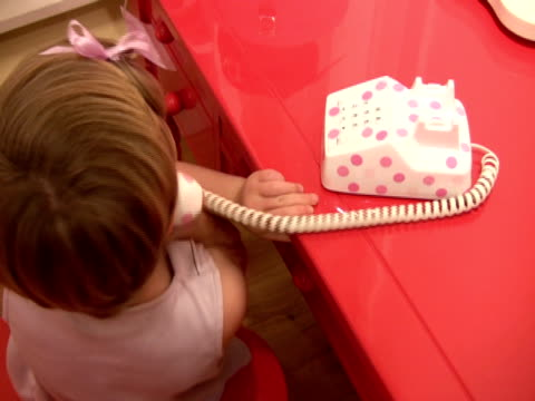 junior executive telephone skills; child talks on toy phone - landline phone stock videos & royalty-free footage