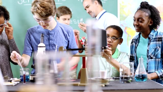 junior high age school students conduct science experiments in classroom. - junior high stock videos & royalty-free footage