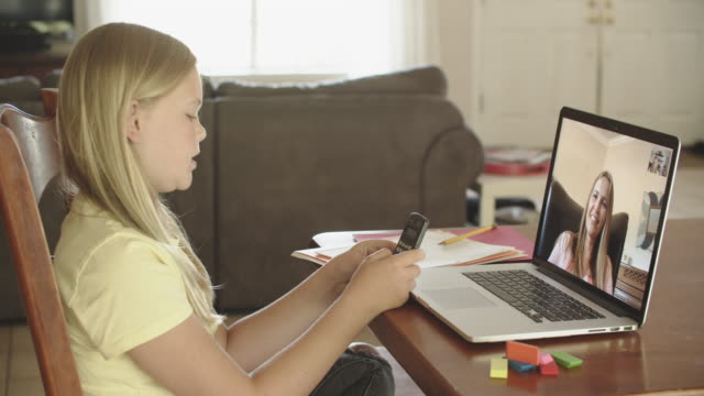 junior high aged girl doing remote learning at home - domestic room stock videos & royalty-free footage