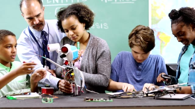 junior high school age students build robot in technology, engineering class. - stem stock videos & royalty-free footage