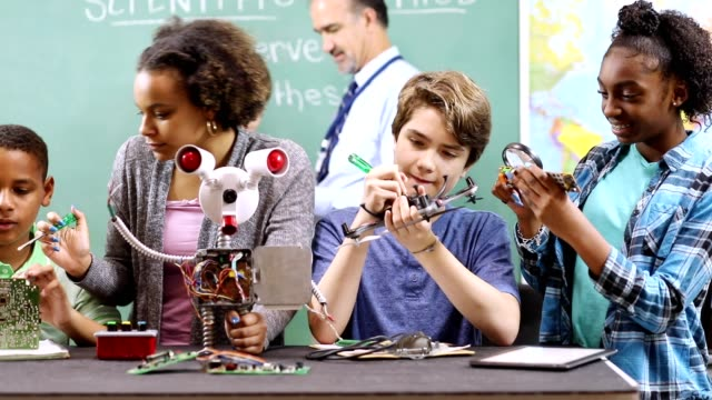 junior high school age students build robot in technology, engineering class. - manufacturing machinery stock videos & royalty-free footage