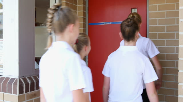 Junior High School Girl Students Arriving for Class