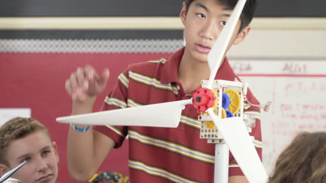 Junior High School Student Demonstrating a Model Wind Turbine