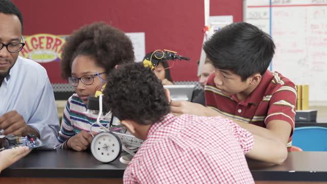 Junior High School Students building a Robot in Classroom