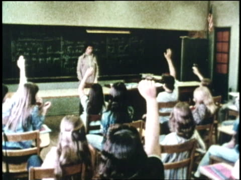 junior high school students raise their hands to ask and answer questions - 1970 stock videos & royalty-free footage